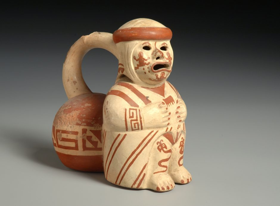 Whistling vessel, sitting human figure, made of fired and painted clay
