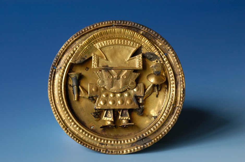 Ear peg disc, depicting figure in ceremonial robes, made of wrought and engraved gilt copper sheet