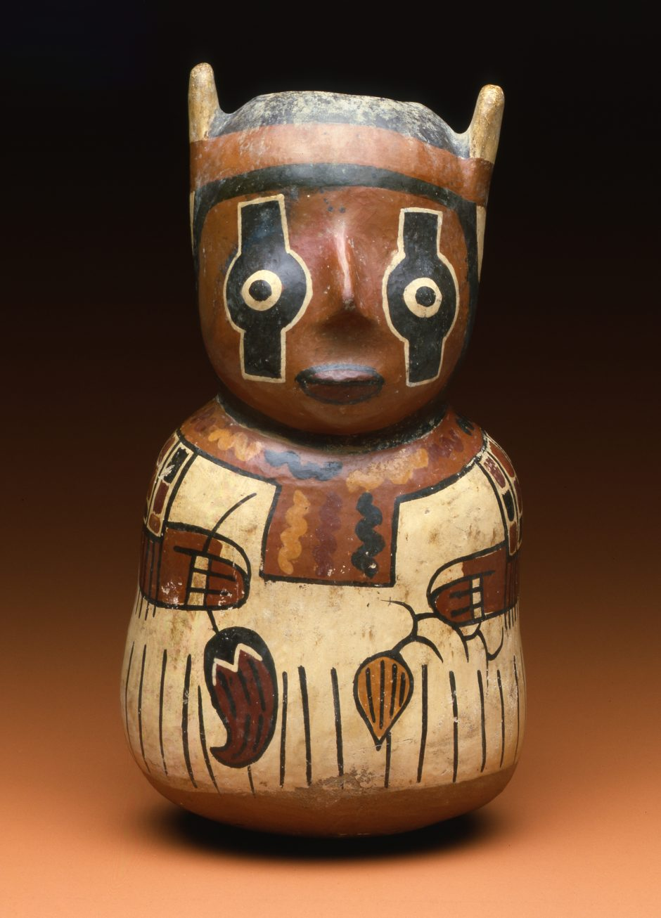 Vessel made of painted and fired clay, depicting a human figure with painted eyes and holding field crops