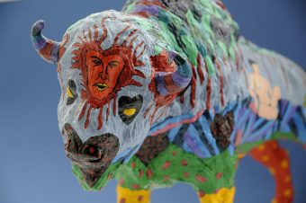 Colourfully painted plastic buffalo