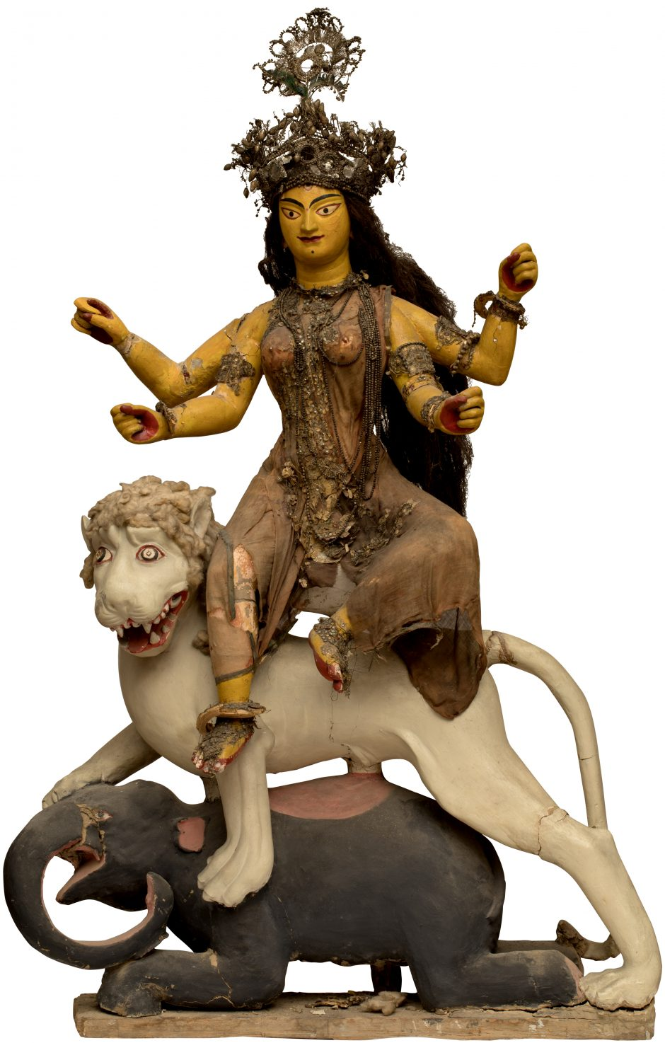 Figure of the goddess Durga with four arms sitting on a lion and an elephant