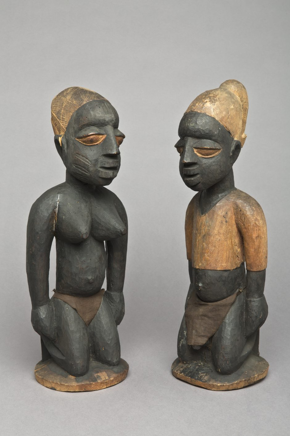 Pair of kneeling figures, female, male