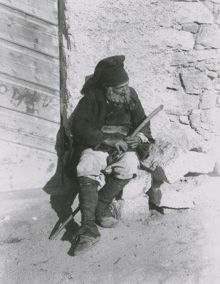 Nuoro, Sardinia, farmer, old man sitting on bricks, pipe, cane, rod,