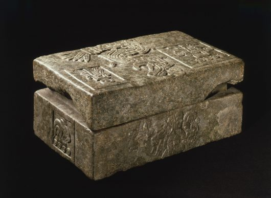 Lidded stone box, decorated with reliefs