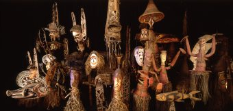 Masks of the South Seas, general view in front of dark background
