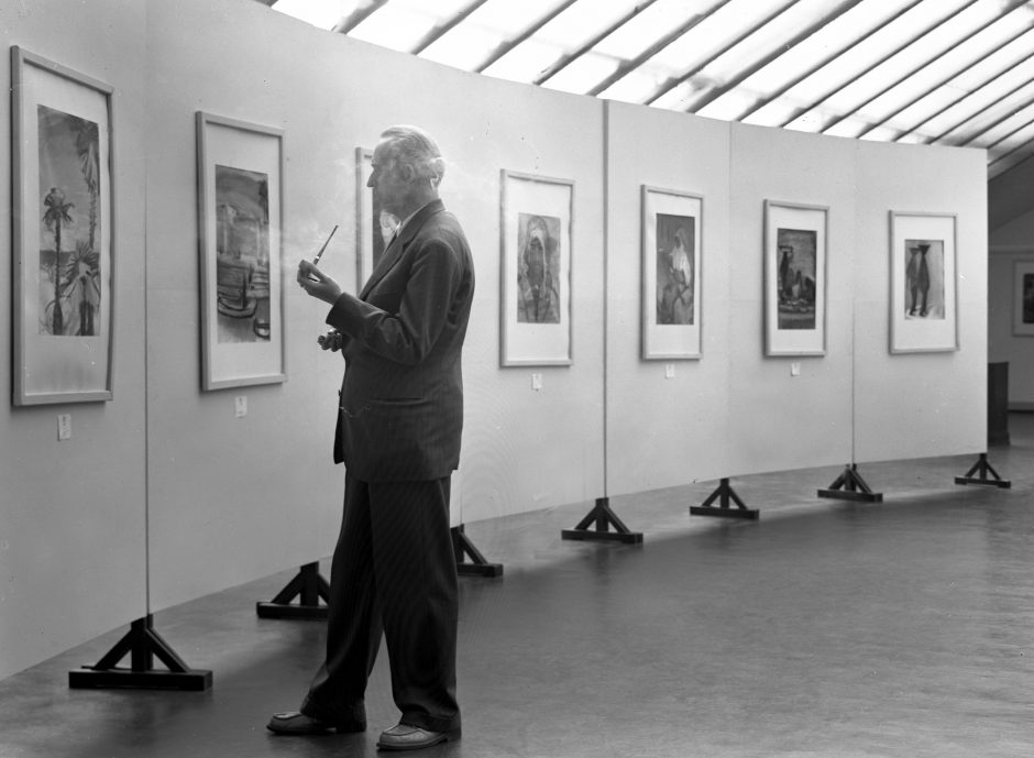 Man smoking, exhibition, paintings, b/w photograph