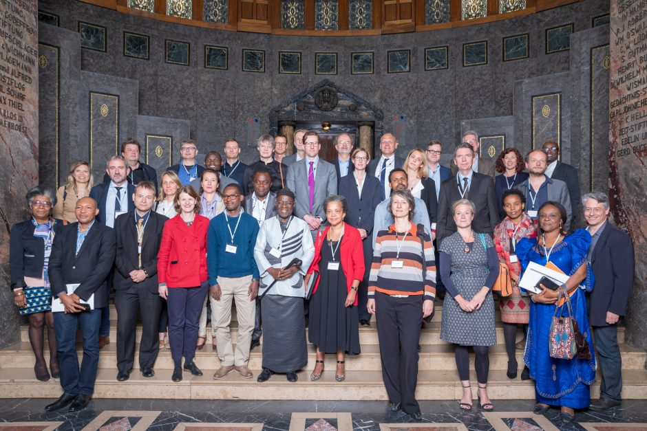 Group picture, people in the foyer, opening discussion on dealing with colonial heritage and cultural cooperation