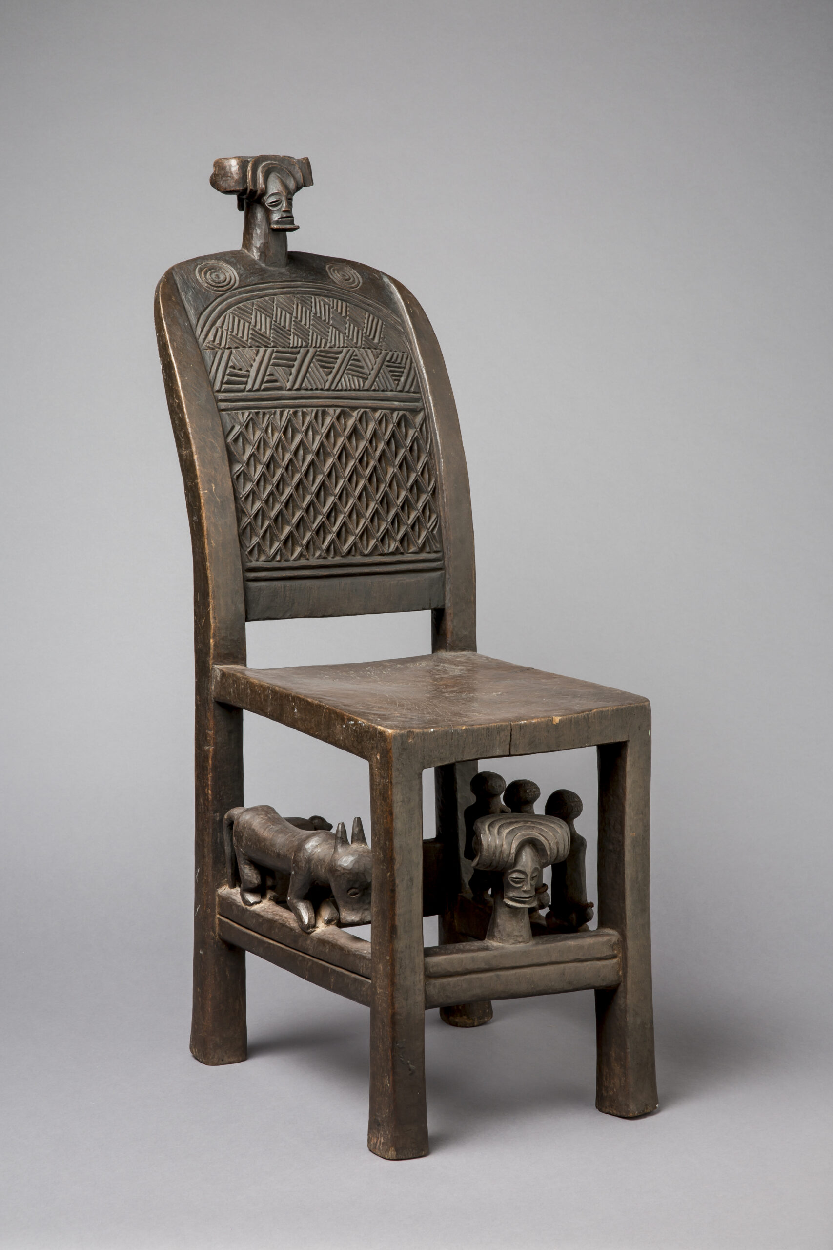 wooden chair with symbolic carvings