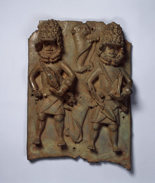 Relief plate with two leopard hunters with equipment