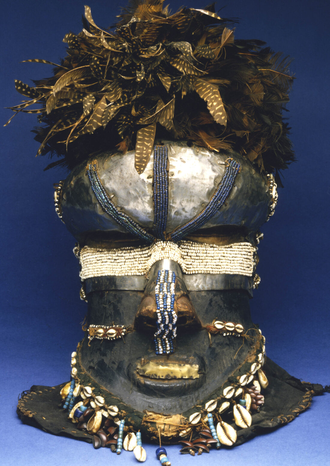 Mask embroidered with pearls and shells and feathers on top