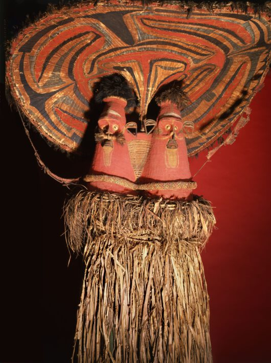 colourful mask with two faces made of bamboo, plant fibres and feathers